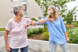 Family connecting with hearing aids and masks